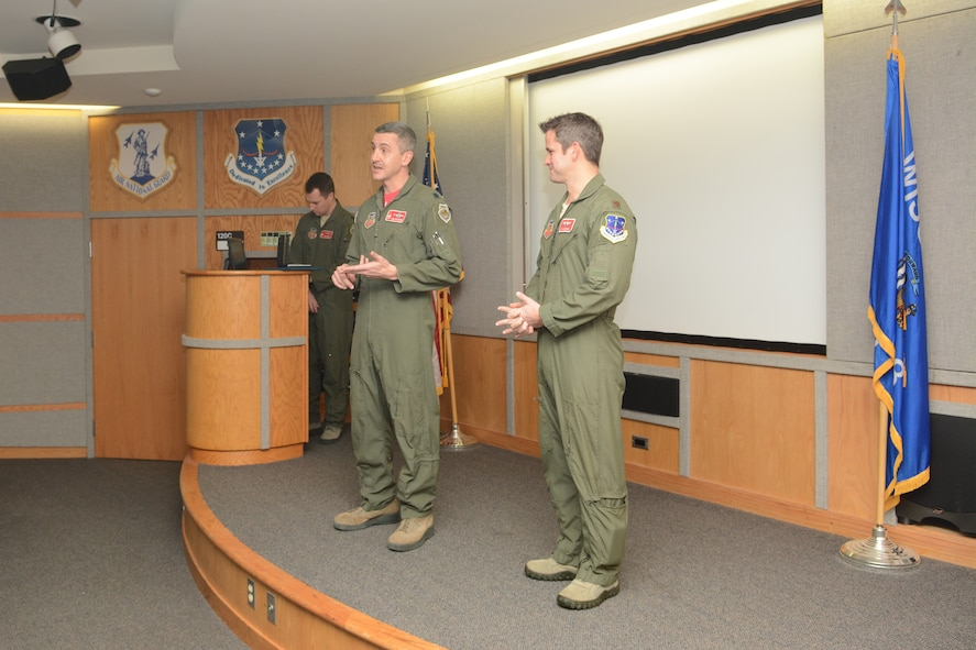 Col. Jon Kalberer, 176th Fighter Squadron commander, speaks about the accomplishments of Maj. Adam Kinzinger, 115th Fighter Wing RC-26 Metroliner pilot, prior to awarding him The Meritorious Service Medal during a ceremony at Truax Field, Madison, Wis., March 5, 2016. Kinzinger received the award for various mission accomplishments including 420 million dollars of drug-related seizures, more than 700 arrests of high-value drug traffickers, and two deployments in support of overseas contingency operations where he executed over 275 combat flight hours and 100 combat sorties. (U.S. Air National Guard photo by Staff Sgt. Andrea F. Rhode)