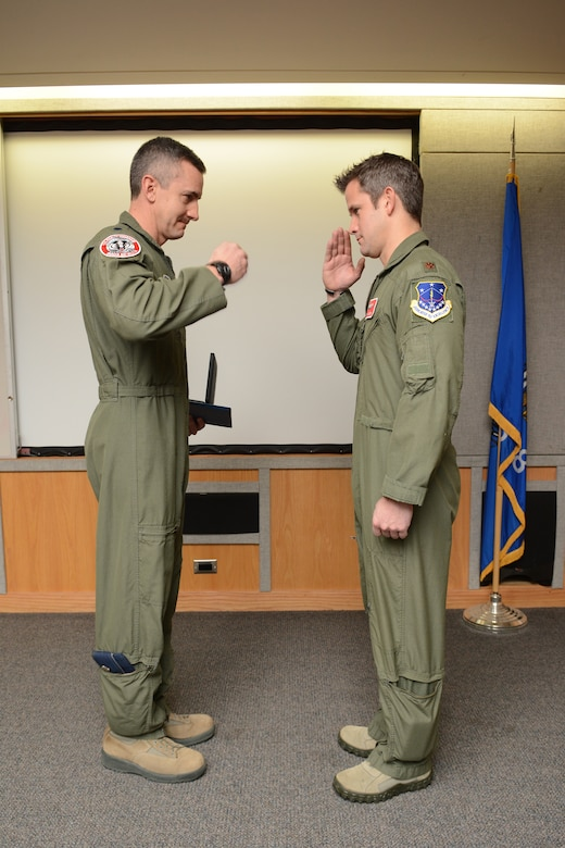 Maj. Adam Kinzinger, 115th Fighter Wing RC-26 Metroliner pilot, salutes Col. Jon Kalberer, 176th Fighter Squadron commander, after he receives The Meritorious Service Medal during a ceremony at Truax Field, Madison, Wis., March 5, 2016. Kinzinger received the award for various mission accomplishments including 420 million dollars of drug-related seizures, more than 700 arrests of high-value drug traffickers, and two deployments in support of overseas contingency operations where he executed over 275 combat flight hours and 100 combat sorties. (U.S. Air National Guard photo by Staff Sgt. Andrea F. Rhode)