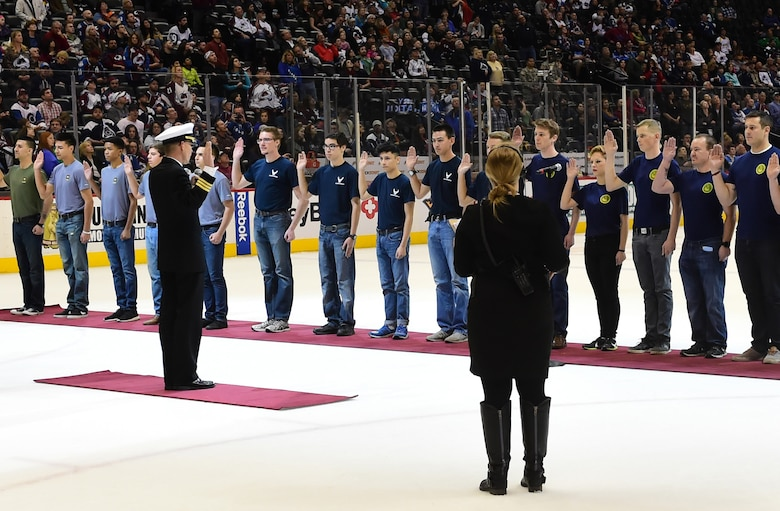 """Prospective military members swore in during intermission at the Colorado Avalanche hockey game March 5, 2016, at the Pepsi Center in Denver, Colo. The recruits took the ice during intermission to be sworn into the United States military during the Avalanche """"Military Appreciation Day."""" (U.S. Air Force photo by Airman 1st Class Luke W. Nowakowski/Released)"""