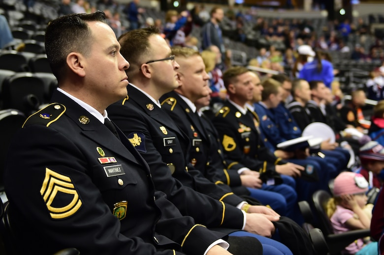 """Military members watch the pregame warm-up before the game between the Colorado Avalanche and the Nashville Predators March 5, 2016, at the Pepsi Center in Denver, Colo. The Avalanche held the fifth annual """"Military Appreciation Day"""" to honor military members for their service to the United States. (U.S. Air Force photo by Airman 1st Class Luke W. Nowakowski/Released)"""