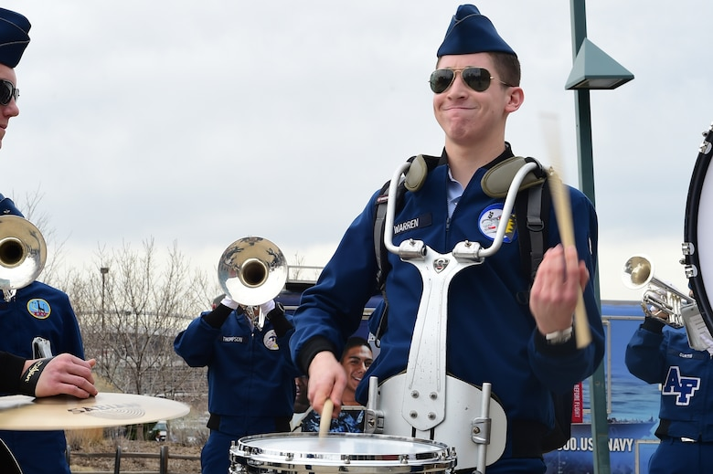 """Air Force Academy band members perform before the Colorado Avalanche game March 5, 2016, at the Pepsi Center in Denver, Colo. The academy was invited to perform for the fifth annual """"Military Appreciation Day"""" held by the Avalanche, which honors United States military members. (U.S. Air Force photo by Airman 1st Class Luke W. Nowakowski/Released)"""