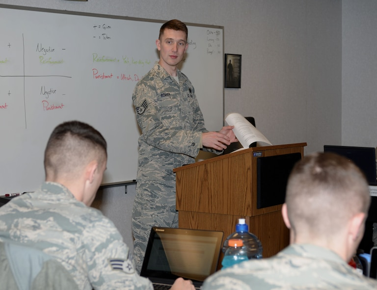 Staff Sgt. Aaron Bonner, 28th Force Support Squadron Airman Leadership School instructor, teaches his class about punishments and reinforcements at Ellsworth Air Force Base, S.D., Feb. 25, 2016. During their time at ALS, Airmen learn useful leadership and life skills to help them become effective supervisors. (U.S. Air Force photo by Airman 1st Class Denise M. Nevins/Released)