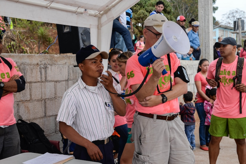 Wilmer Alexander Vásquez, Tierra Colorada community leader helps organize residents from various villages in La Paz Department, Honduras, March 5, 2016, during a volunteer Chapel Hike. The hikes are a means for members of Joint Task Force-Bravo to provide food to villages in various communities near Soto Cano Air Base and develop a greater understanding and appreciation for those who live there. (U.S. Air Force photo by Staff Sgt. Westin Warburton/Released)