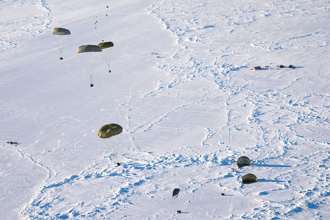More than 12,000 pounds of cargo fall out of the back of a C-17 Globemaster III over the Arctic Ocean in support of the U.S. Navy Submarine Forces' Ice Exercise 2016. ICEX 2016 is a five-week exercise designed to research, test and evaluate operational capabilities in the Arctic region. (U.S. Air Force photo by Staff Sgt. Sheila deVera)