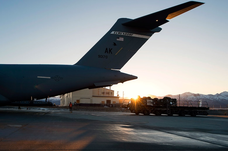 A K-loader prepares to load equipment on a C-17 Globemaster III cargo ramp at Joint Base Elmendorf-Richardson, Alaska, March 2, 2016, in support of Ice Exercise 2016 in the Arctic Ocean. ICEX 2016 is a five-week exercise designed to research, test and evaluate operational capabilities in the Arctic by the U.S. Navy Submarine Forces. (U.S. Air Force photo by Staff Sgt. Sheila deVera)