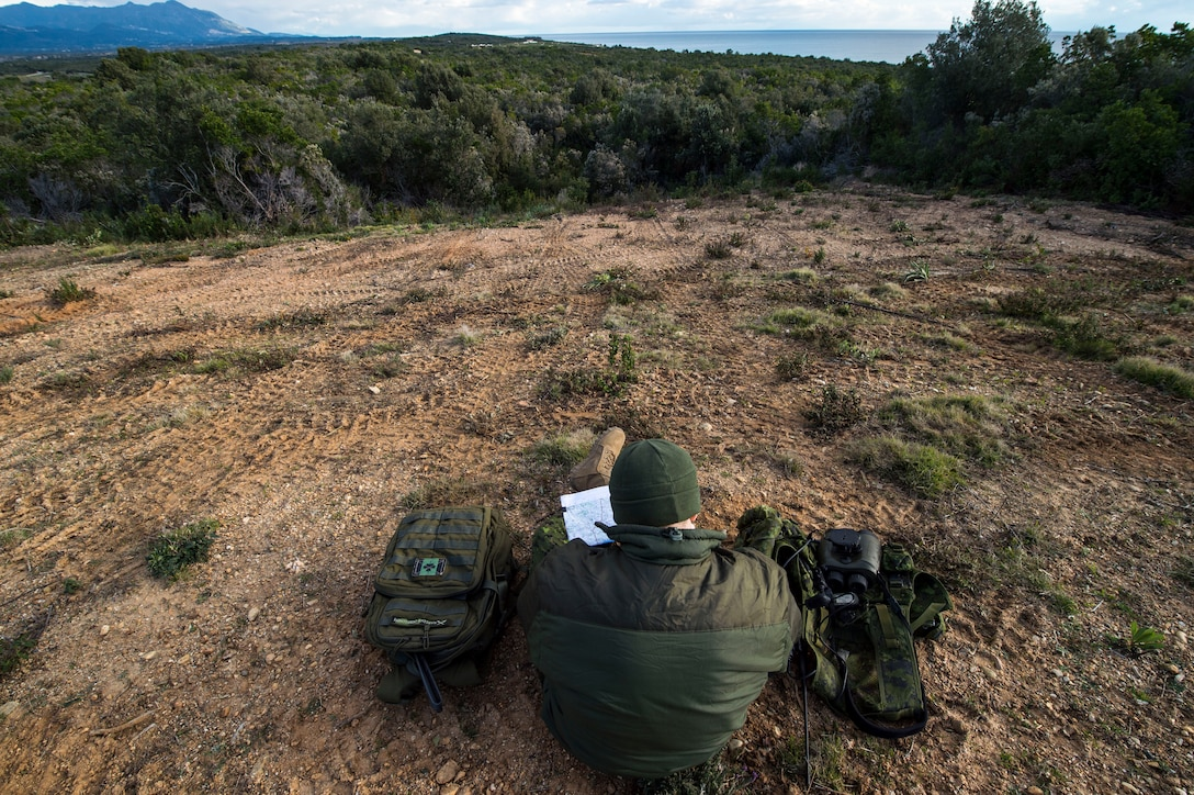 Master Bombardier Mathiew Marcoux-Desrochers, a joint terminal attack controller from the Yankee Battery of the 2nd Regiment, Royal Canadian Horse Artillery, verifies coordinates on a map as part of training during exercise SERPENTEX 16, March 7, 2016. Training and theater security cooperation engagements with U.S. allies and partners, such as Exercise SERPENTEX, demonstrate a shared commitment to promoting security and stability. (U.S. Air Force/Staff Sgt. Sara Keller)