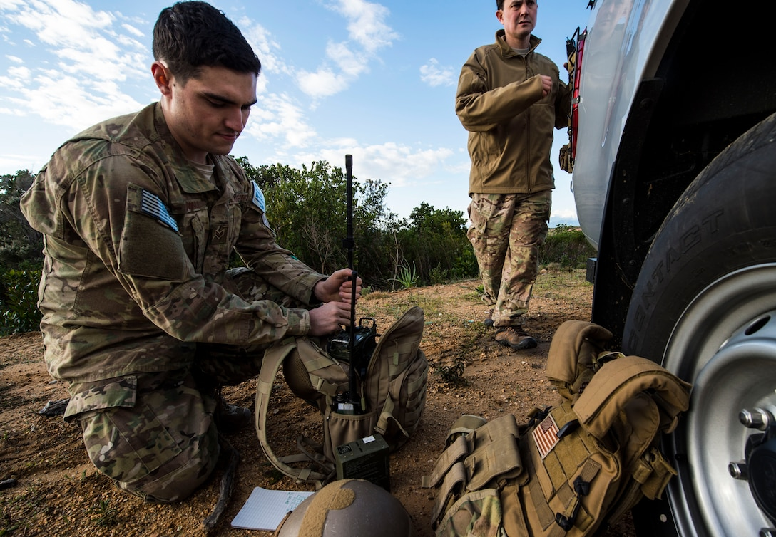 Senior Airman Gage Duvall, 2nd Air Support Operations Squadron joint terminal attack controller, prepares his radio during exercise SERPENTEX 16, March 7, 2016. SERPENTEX 16 is an annual French-led exercise that is designed to enhance NATO operations and training between allies and partners.  The exercise helped enhance readiness and reinforce relations in a joint and combined training environment. (U.S. Air Force photo/Staff Sgt. Sara Keller)