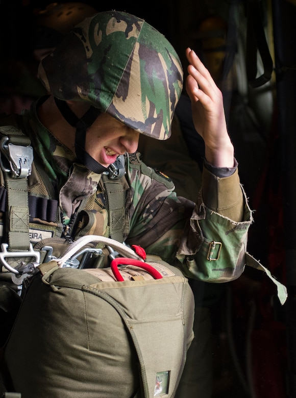 A Portuguese paratrooper covers his face before jumping from a C-130J Super Hercules assigned to the 37th Airlift Squadron during exercise Real Thaw 16 in Beja, Portugal, Feb. 25, 2016. Approximately 50 paratroopers were airdropped by the 37th AS during the event. (U.S. Air Force photo/Senior Airman Jonathan Stefanko)