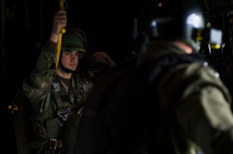 A Portuguese paratrooper waits for the signal to jump from the C-130J Super Hercules assigned to the 37th Airlift Squadron during exercise Real Thaw 16 in Beja, Portugal, Feb. 25, 2016. Approximately 50 paratroopers were airdropped by the 37th AS during the event. (U.S. Air Force photo/Senior Airman Jonathan Stefanko)