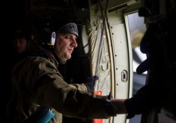 A Portuguese jumpmaster looks out of a C-130J Super Hercules assigned to the 37th Airlift Squadron during exercise Real Thaw 16 in Beja, Portugal, Feb. 25, 2016. Approximately 50 paratroopers were airdropped by the 37th AS during the event. (U.S. Air Force photo/Senior Airman Jonathan Stefanko)