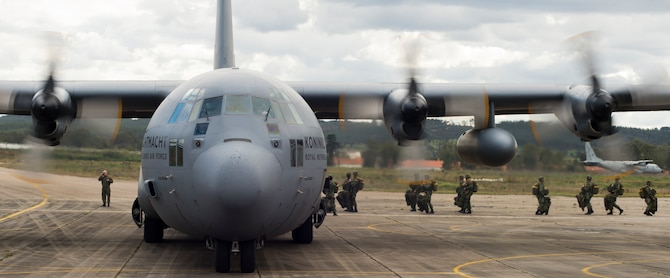 Portuguese paratroopers load onto a Royal Netherlands air force C-130H Hercules during exercise Real Thaw 16 in Beja, Portugal, Feb. 25, 2016. Royal Netherlands air force worked alongside the U.S. to airdrop more than 100 paratroopers. (U.S. Air Force photo/Senior Airman Jonathan Stefanko)