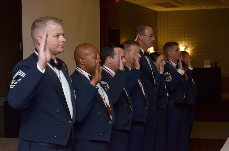 Nine new Air Force chief master sergeants and chief selects raise their right hands and repeat the Chief's Oath during the Space Coast Chief Master Sergeant Recognition Ceremony March 5, 2016, in Cocoa Beach, Florida. Approximately one percent of Airmen achieve the rank of chief, the highest enlisted rank in the Air Force. (U.S. Air Force photo by Tech. Sgt. Michael Means)