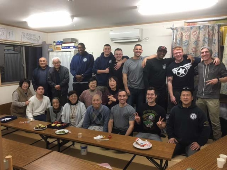 Takuya Kanto, a civilian firefighter with the 35th Civil Engineer Squadron, far right, sits with other 35th CES firefighters and citizens from Rikuzentakata Village, Japan, Dec. 22, 2015. Kanto and other 35 CES Airmen often visit villages like Rikuzentakata, areas devastated by the 2011 Great East Japan earthquake and tsunami, to provide food and assist with clean-up projects, further strengthening the relationship between the U.S. and Japan. (Courtesy Photo)