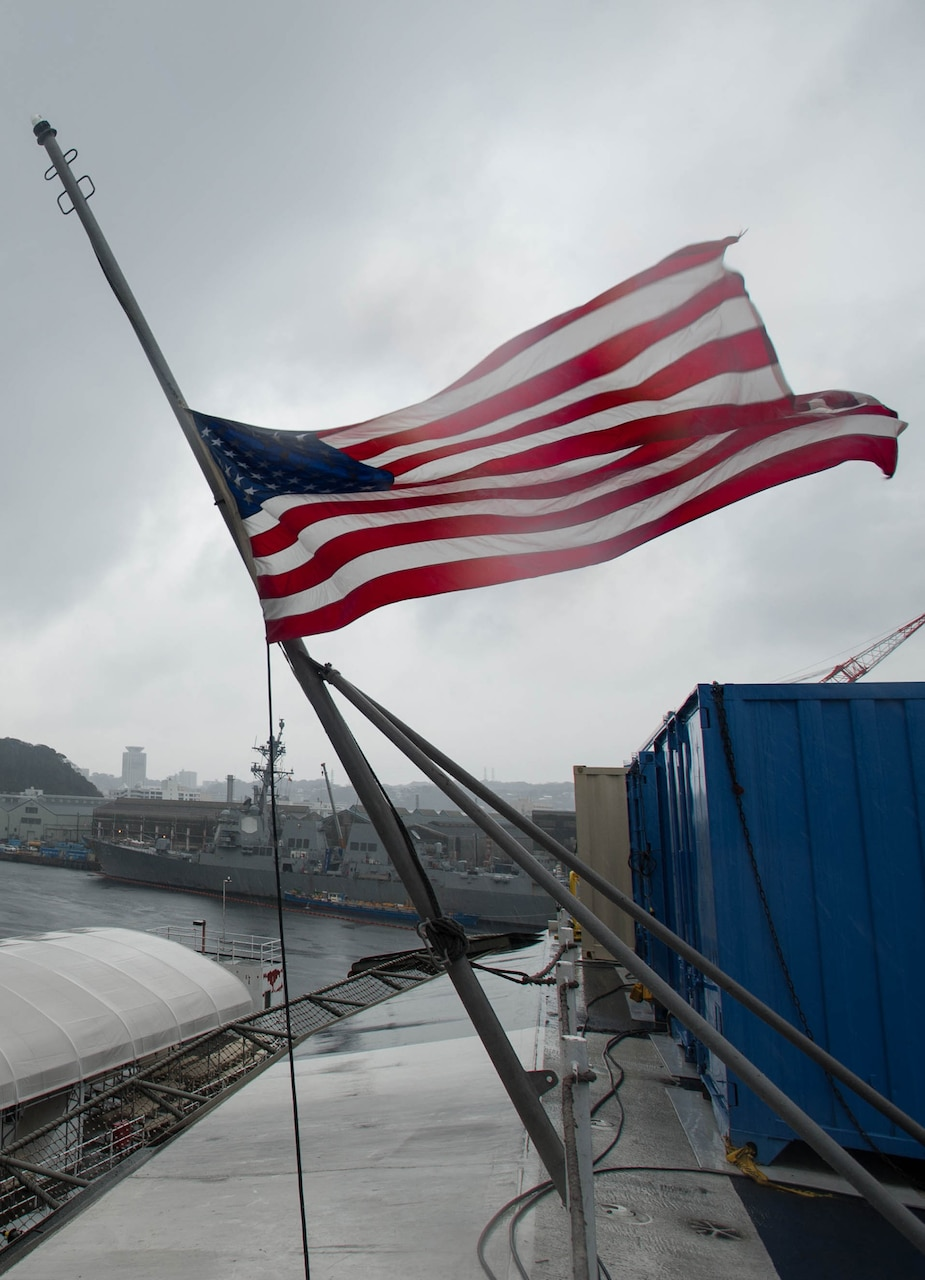 160307-N-OI810-232 YOKOSUKA, Japan (March 7, 2016) The Ensign is flown at half-mast aboard the U.S. Navy's only forward-deployed aircraft carrier USS Ronald Reagan (CVN 76) in remembrance of former first lady Nancy Reagan. Mrs. Reagan served as the ship's sponsor since its commissioning in 2003. (U.S. Navy photo by Mass Communication Specialist 3rd Class Nathan Burke/Released)