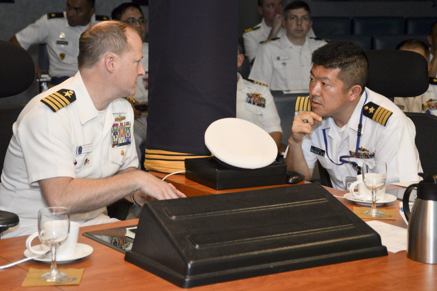 130305-N-CZ848-120 MANILA, Philippines (Mar. 5, 2016) – Captain Ron Oswald, left, and Capt. Tsugunori Niizuma of the Japan Maritime Self-Defense Force, have a conversation during trilateral talks between the U.S., Philippines and Japan aboard USS Blue Ridge (LCC 19), in Manila, Philippines. The trilateral talks are being held to enhance cooperation and strengthen relationships to best provide security and stability in the Indo-Asia Pacific. (U.S. Navy photo by Mass Communication Specialist 2nd Class Jason Kofonow/Released)