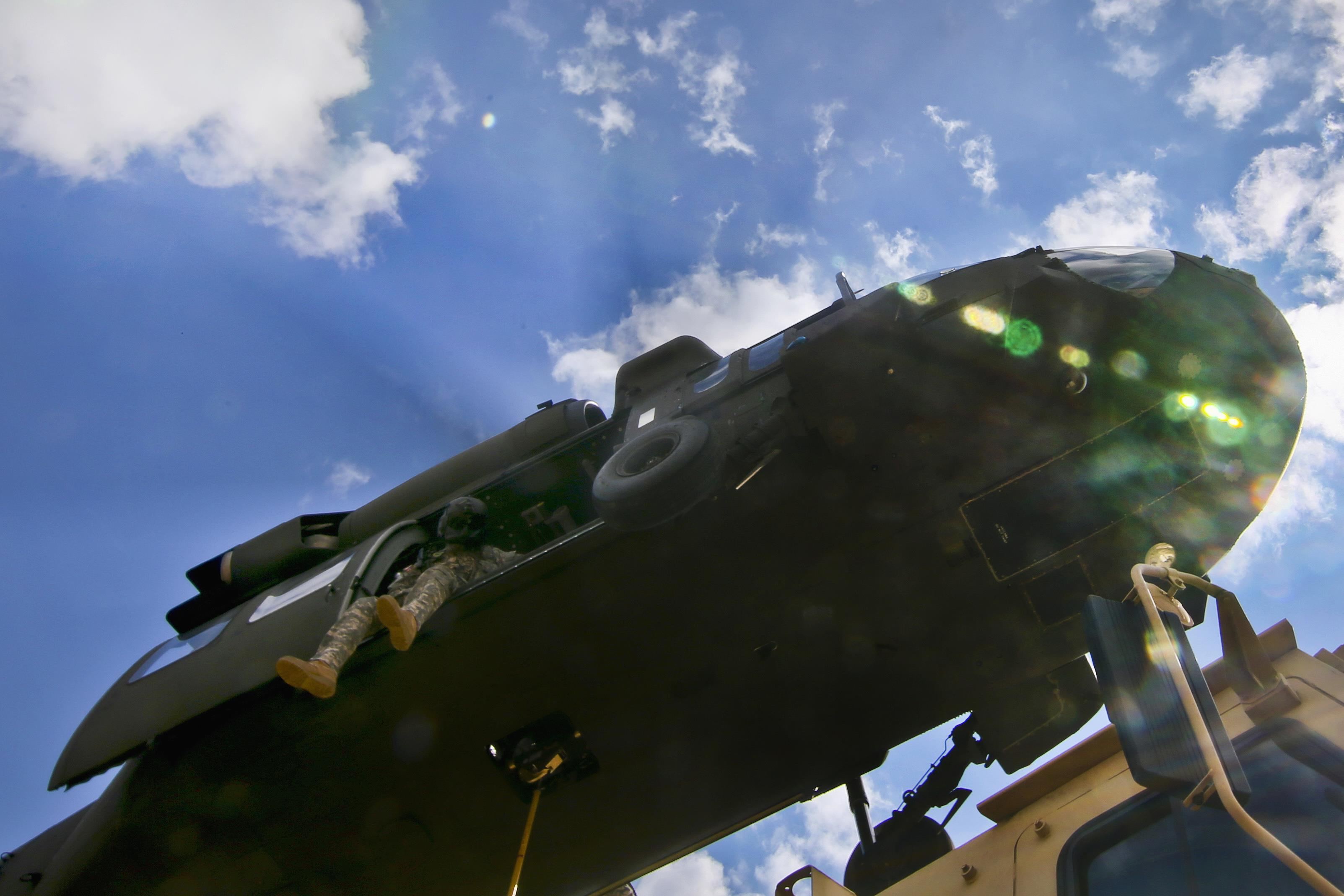 An Army crew chief looks down on cargo during slingload training at Coyle  drop zone on 1c5d8e210
