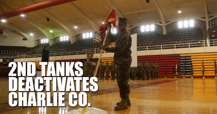 Gunnery Sgt. Derrick A. Jackson, the Charlie Company first sergeant with 2nd Tank Battalion, retires the company guidon during Charlie Company's deactivation ceremony at Camp Lejeune, N.C., March 4, 2016. Charlie Company, activated in 1941, has taken part in some of the America's largest battles to include World War II (Tarawa, Saipan), The Vietnam War, Operations Desert Storm and Shield, and Operation Iraqi Freedom (Fallujah).(U.S. Marine Corps illustration by Cpl. Joey Mendez)