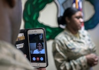 Staff Sgt. Sushil Torres addresses the audience at her reenlistment while mom Carolyn Pilgrim looks in via Apple's Facetime app at Vance Air Force Base, Oklahoma, March 1. (U.S. Air Force photo by David Poe)