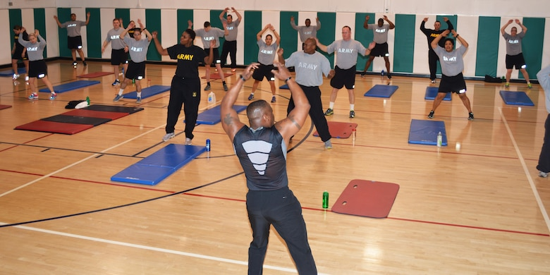 David Durham conducts a full body boot camp during the 80th Training Command health and fitness training event for individuals with body weight and Army Physical Fitness Test challenges at the command headquarters, Richmond, Va., March 5, 2016.