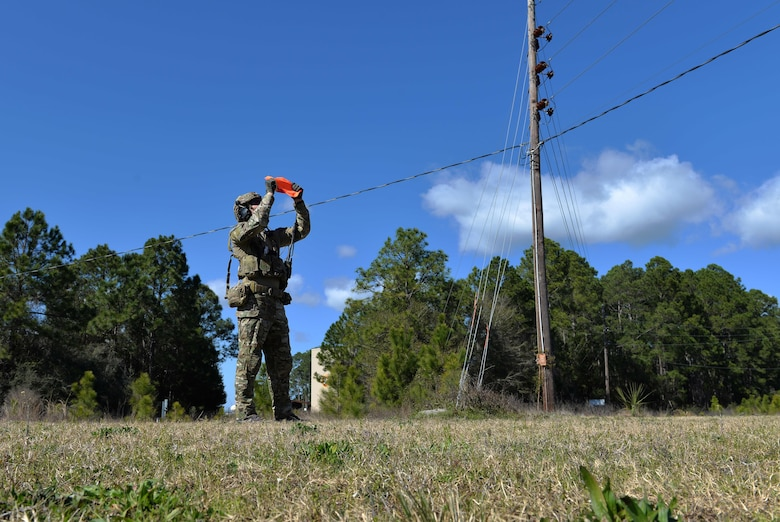 An Army Ranger from the 75th Ranger Regiment, 3rd Ranger Battalion, signals an aircraft to his team's position at Hurlburt Field, Fla., Feb. 11, 2016. During this exercise, Rangers radioed coordinates to F-35A Lightning II pilots to simulate close air support. (U.S. Air Force photo/Senior Airman Andrea Posey)