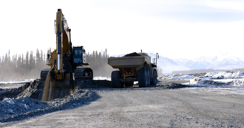 Airmen from the 354th Civil Engineer Squadron operate heavy equipment March 2, 2016, in Delta Junction, Alaska. The Airmen haul truck-loads of dirt to different areas to create a trail system on the Oklahoma Range. (U.S. Air Force photo by Airman 1st Class Cassandra Whitman/Released)