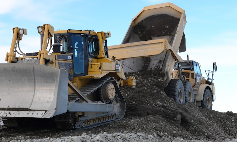 "A rock truck operated by a 354th Civil Engineer Squadron ""dirt boy"" dumps dirt to make a trail system March 2, 2016, in Delta Junction, Alaska. The 354th CES ""dirt boyz"" and structural craftsman Airmen work for approximately 38 days to prepare the Oklahoma Range for RED FLAG-Alaska's strategic training mission. (U.S. Air Force photo by Airman 1st Class Cassandra Whitman/Released)"