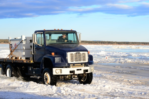 Tech. Sgt. John Jockusch, the 354th Civil Engineer Squadron noncommissioned officer in charge of range structural maintenance, drives a truck over the ice bridge in Delta Junction, Alaska, March 2, 2016. The ice bridge is used to get to and from the Oklahoma Range, part of RED FLAG-Alaska's strategic training area, and is built by Airmen, soldiers and DoD civilians. (U.S. Air Force photo by Airman 1st Class Cassandra Whitman/Released)