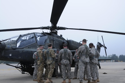 Aviators from 1-158th Assault Reconnaissance Battalion (ARB), conduct a final mission brief in Conroe, Texas, before participating in the last official flight of the AH-64 Apache Helicopter in the U.S. Army Reserve. Mar. 6, 2016. 1-158th ARB is a direct reporting unit to the 11th Theater Aviation Command. The 11th Theater Aviation Command (TAC) is the only aviation command in the Army Reserve. (U.S. Army Photo by Capt. Matthew Roman, 11th Theater Aviation Command Public Affairs Officer)