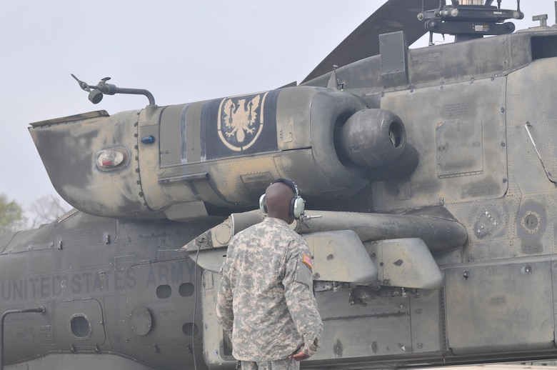 A 1-158th Assault Reconnaissance Battalion (ARB) soldier conducts a final maintenance check on the AH-64 Apache Helicopter before its ceremonial final flight in Conroe, Texas, Mar. 6, 2016. 1-158th ARB is a direct reporting unit to the 11th Theater Aviation Command. The 11th Theater Aviation Command (TAC) is the only aviation command in the Army Reserve. (U.S. Army Photo by Capt. Matthew Roman, 11th Theater Aviation Command Public Affairs Officer)