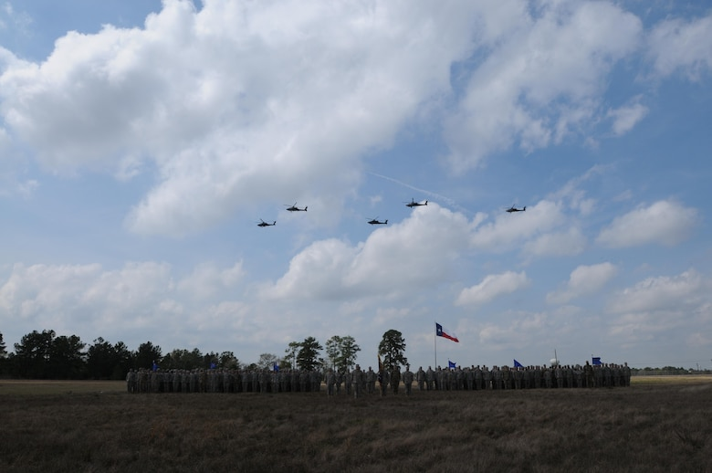 "Soldiers from, 1-158th Assault Reconnaissance Battalion (ARB), stand in a battalion formation as five AH-64 Apache Helicopter conduct a ceremonial ""fly-over"", in Conroe, Texas, to commemorate the final flight of the Apache helicopter in the U.S. Army Reserve, Mar. 6, 2016. 1-158th ARB is a direct reporting unit to the 11th Theater Aviation Command. The 11th Theater Aviation Command (TAC) is the only aviation command in the Army Reserve. (U.S. Army Photo by Capt. Matthew Roman, 11th Theater Aviation Command Public Affairs Officer)"