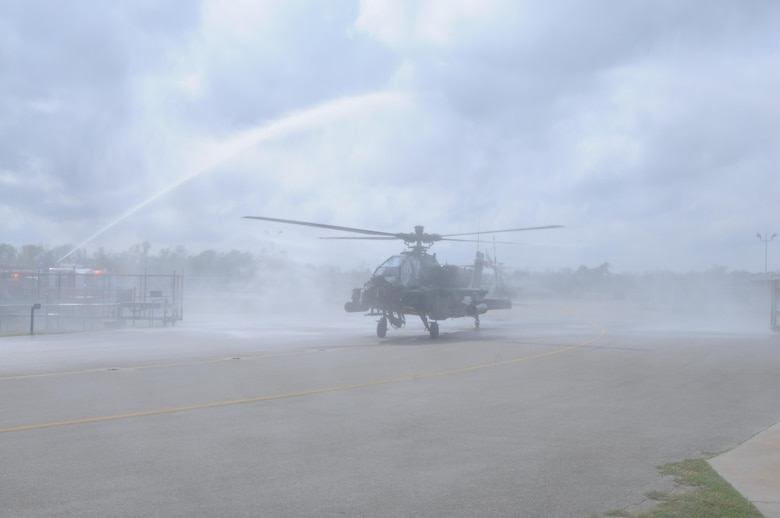 An AH-64 Apache Helicopter, from 1-158th Assault Reconnaissance Battalion (ARB), taxis under fire hoses during a ceremony in Conroe, Texas, to commemorate the final flight of the Apache helicopter in the U.S. Army Reserve, Mar. 6, 2016. 1-158th ARB is a direct reporting unit to the 11th Theater Aviation Command. The 11th Theater Aviation Command (TAC) is the only aviation command in the Army Reserve. (U.S. Army Photo by Capt. Matthew Roman, 11th Theater Aviation Command Public Affairs Officer)