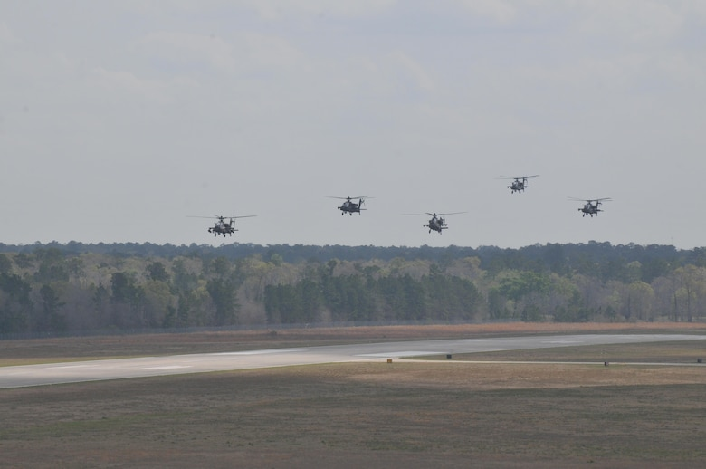 "Five AH-64 Apache Helicopters, belonging to 1-158th Assault Reconnaissance Battalion (ARB), conduct ""fly-by"" in Conroe, Texas, during a ceremony to commemorate the last official flight of the Apache Helicopter in the U.S. Army Reserve, Mar. 6, 2016. 1-158th ARB is a direct reporting unit to the 11th Theater Aviation Command. The 11th Theater Aviation Command (TAC) is the only aviation command in the Army Reserve. (U.S. Army Photo by Capt. Matthew Roman, 11th Theater Aviation Command Public Affairs Officer)"