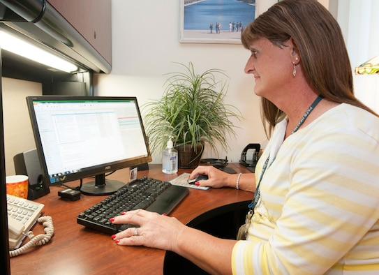 Laura Perry, a 60-year-old transgender civilian Airman who works as a social worker, checks emails at the mental health clinic on Patrick Air Force Base, Fla., Feb. 22, 2016. Perry decided to physically become a woman after serving 20 years in the Air Force, and now volunteers for a transgender advocacy group. (U.S. Air Force photo/Sean Kimmons)