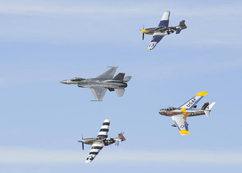 A U.S. Air Force F-16 Fighting Falcon, front, leads a formation followed by two P-51 Mustangs, top and bottom, and an F-86 Sabre, rear, during the 2016 Heritage Flight Training and Certification Course at Davis-Monthan Air Force Base, Ariz., March 4, 2016. Established in 1997, the HFTCC certifies civilian pilots of historic military aircraft and U.S. Air Force pilots to fly in formation together during the upcoming air show season. (U.S. Air Force photo by Senior Airman Chris Massey/Released)