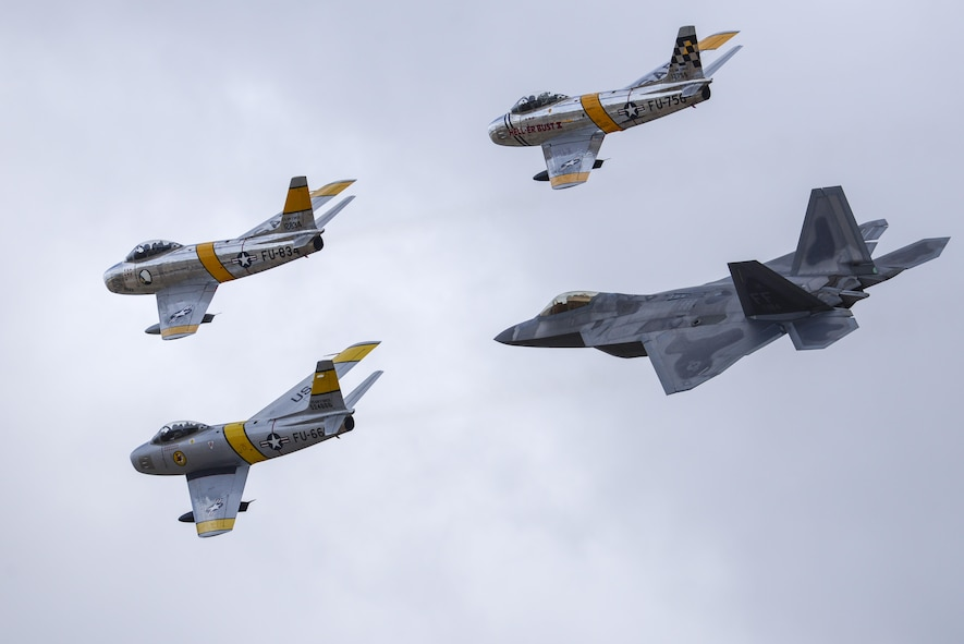Three F-86 Sabres and a U.S. Air Force F-22 Raptor fly in formation during the 2016 Heritage Flight Training and Certification Course at Davis-Monthan Air Force Base, Ariz., March 6, 2016. Established in 1997, the HFTCC certifies civilian pilots of historic military aircraft and U.S. Air Force pilots to fly in formation together during the upcoming air show season. (U.S. Air Force photo by Senior Airman Chris Massey/Released)