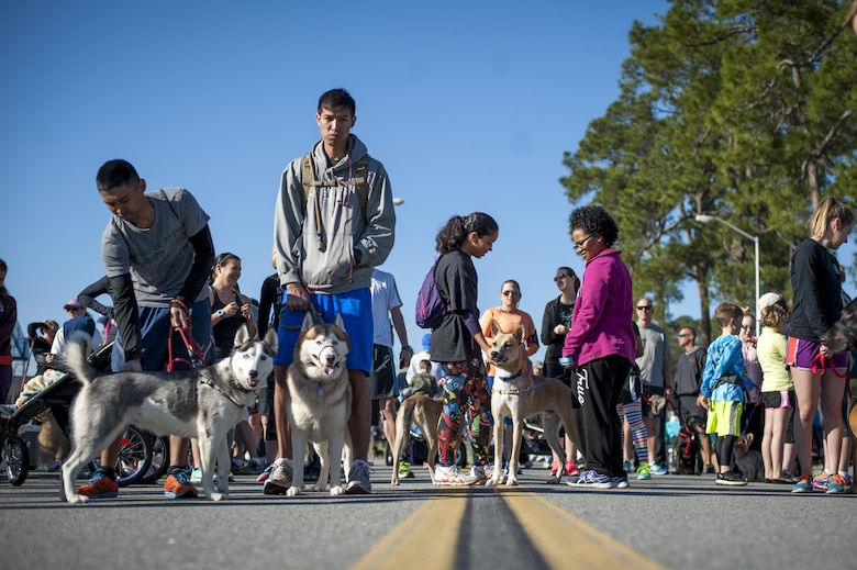Participants line up to begin the Family & Furry Friends 5k, March 5, 2016, at Moody Air Force Base, Ga. The event was designed to encourage families to maintain their health and wellness by participating in physical activity with their dogs. (U.S. Air Force photo by Airman 1st Class Lauren M. Johnson)