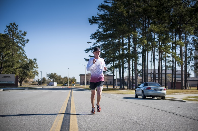Carson Locke, son of U.S. Air Force Col. Joseph Locke, 93d Air Ground Operations Wing commander, runs through the finish line during the Family & Furry Friends 5k, March 5, 2016, at Moody Air Force Base, Ga. Carson was the first to finish the 5k in just over 23 minutes. (U.S. Air Force photo by Airman 1st Class Lauren M. Johnson)