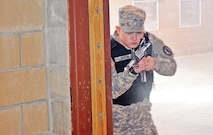 Pvt. Taylor Layton, 977th Military Police Company, 97th MP Battalion, practices room clearing during the law enforcement academy at Fort Riley Feb. 19.