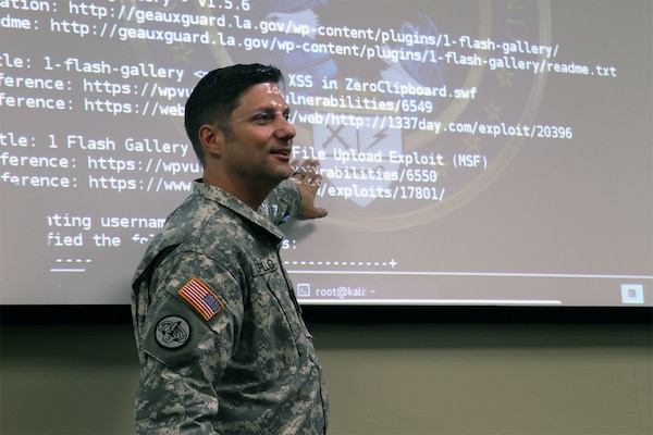 Louisiana Army National Guard Lt. Col. Henry T. Capello, chief communications plans officer, trains members of the Cyber Defense Incident Response Team to defend the state's cyber assets at Louisiana State University's Stephenson Disaster Management Institute in Baton Rouge, Nov. 15, 2015. The team was created to respond to cyber events within Louisiana by securing and restoring affected networks and defeating threats. It is made up of soldiers and airmen who have technology backgrounds in both their civilian and military careers. Louisiana Army National Guard photo by Spc. Garrett L. Dipuma