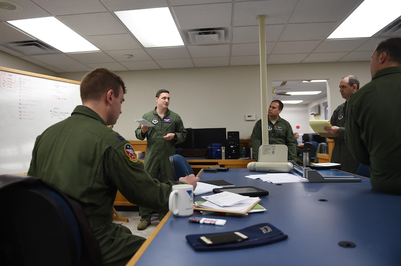 ALTUS AIR FORCE BASE, Okla. – Members of the 54th Air Refueling Squadron plan for the Altus Air Force Base Quarterly Exercise Program ALTEX 16A, March 3, 2016, inside the mission planning room at Altus AFB, Okla. For this exercise, multiple units assigned to the 97th Air Mobility Wing coordinated with members of the 62nd Airlift Wing from Joint Base Lewis-McChord, Wash. and the 60th AMW from Travis Air Force Base, Calif. to practice tactical scenarios that are prevalent in the current hostile areas of the Middle East. (U.S. Air Force photo by Senior Airman Dillon Davis/Released)