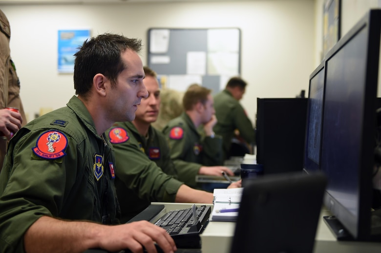 U.S. Air Force Capt. Wes Wilkening, 58th Airlift Squadron inputs objective area information during the planning phase of Altus Air Force Base Quarterly Exercise Program ALTEX 16A, March 3, 2016, inside the mission planning room at Altus AFB, Okla. The main objective for the exercise was formal training unit development and creating a realistic tactical scenario that relates to the current emerging tactical mission requirements in the Middle East. (U.S. Air Force photo by Senior Airman Dillon Davis/Released)