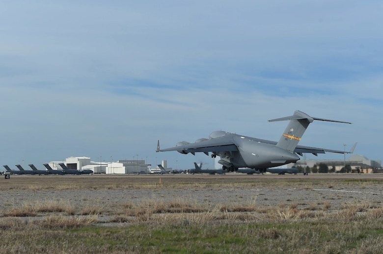 A U.S. Air Force C-17 Globemaster III cargo aircraft takes off, March 4, 2016, from the flightline of Altus Air Force Base, Okla. Eight refueling and cargo aircraft from the base flew in support of the Altus Air Force Base Quarterly Exercise Program (ALTEX) which was established to enhance aircrew instructor opportunities and provide exposure to realistic and emerging tactical scenarios. (U.S. Air Force photo by Senior Airman Dillon Davis/Released)