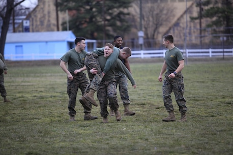 Upland, Calif.-Native Sgt. Matthew Bentley, a data systems technician with Chemical Biological Incident Response Force (CBIRF), U.S. Marine Forces Command (MARFORCOM), fireman carries another Marine during a battalion-wide physical training (PT) session. CBIRF Corporals led the battalion in a PT event ranging from pushups and lunges to buddy drags and fireman carry drills the morning before their graduation from Corporals Leadership Course, Feb. 26, 2016. The noncommissioned officers completed the 3 week course curriculum that included sword and guidon manual, land navigation, Marine Corps promotion system for sergeants and below and other small unit leader skills and traits. (Official USMC Photo by Sgt. Santiago G. Colon Jr./Released)