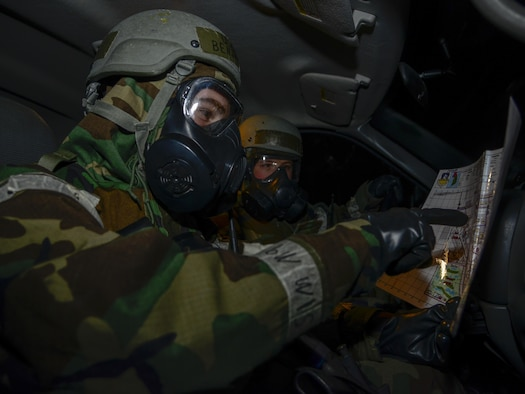 Airmen 1st Class Benjamin Thompson and Justin Eason, 51st Civil Engineer Squadron emergency management apprentices, review survey areas during exercise Beverly Midnight 16-01 on Osan Air Base, Republic of Korea, March 8, 2016. The emergency management teams are the first to respond after attacks to search for injured personnel, enemy activity and structural damage. (U.S. Air Force photo by Senior Airman Kristin High/Released)