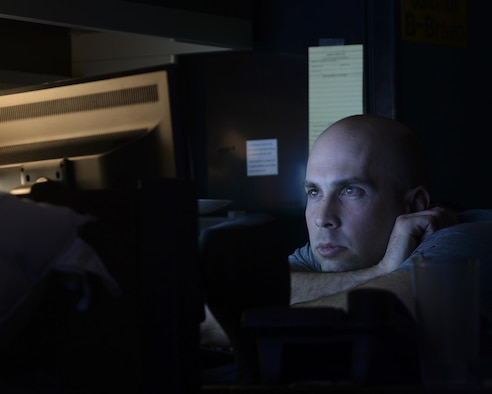 Staff Sgt. Jason Pominski, 319th Missile Squadron facility manager, watches a video during his downtime Feb. 8, 2016, at a Missile Alert Facility in the F.E. Warren Air Force Base, Wyo., missile complex. Facility managers lead the topside enlisted Airmen in MAFs and take care of the grounds and facility. (U.S. Air Force photo by Senior Airman Jason Wiese)