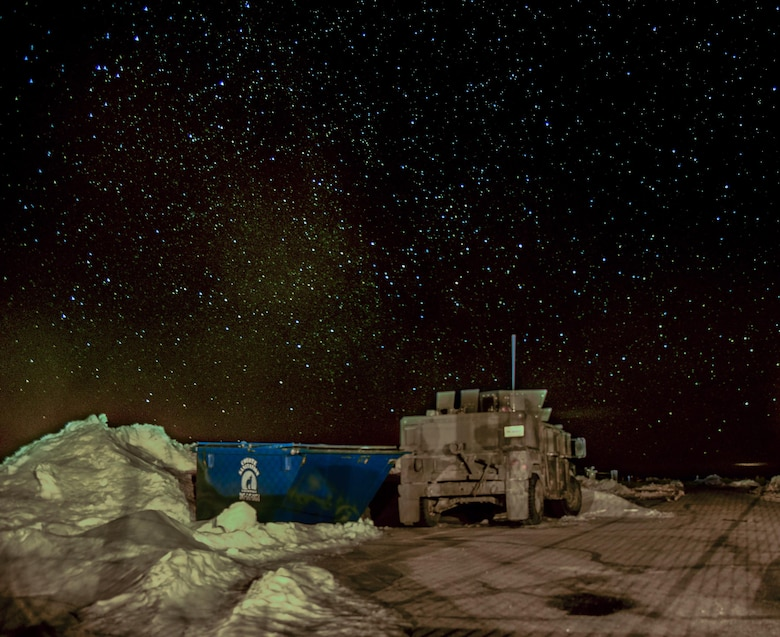 A 90th Missile Security Forces Squadron Humvee sits on the access road of a Missile Alert Facility in the F.E. Warren Air Force Base, Wyo., missile complex, in this composite of two photos taken on Feb. 8, 2016. Security forces, missileers and other 90MWAirmen stay vigilant 24/7. (U.S. Air Force photo illustration by Senior Airman Jason Wiese)