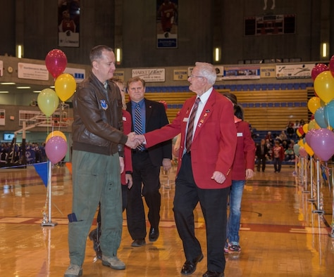 Col. David Ballew, 5th Bomb Wing vice commander, shakes hands with a Minot community member during the pre-game ceremonies at the North Dakota Special Olympics in Minot, N.D., March 4, 2016. Ballew and Col. Michael Lutton, 91st Missile Wing commander, among other Minot AFB members volunteered to help at the Special Olympics. (U.S. Air Force photo/Airman 1st Class Christian Sullivan)