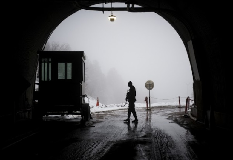 CHEYENNE MOUNTAIN AIR FORCE STATION, Colo. - Senior Airman Ricardo Collie, a 721st Security Forces member, patrols the north gate of the Cheyenne Mountain Complex at Cheyenne Air Force Station, Colorado. Collie is one of many security layers to enter more than a mile inside a Colorado mountain to a complex of steel buildings that sit in caves. (Photo by Staff Sgt. Andrew Lee )