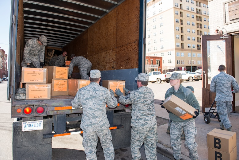Members of the 233d Space Group, Colorado Air National Guard, Greeley, Colo. help load boxes of medical supplies onto one of their vehicles in order to help distribute them to all corners of Colorado for the annual 9Health Fair. This Innovative Readiness Training program not only provides support to the community, it also helps members of the 233 SG accomplish mandatory training time driving the semi-trucks. (U.S. Air National Guard photo by Senior Master Sgt. John Rohrer)