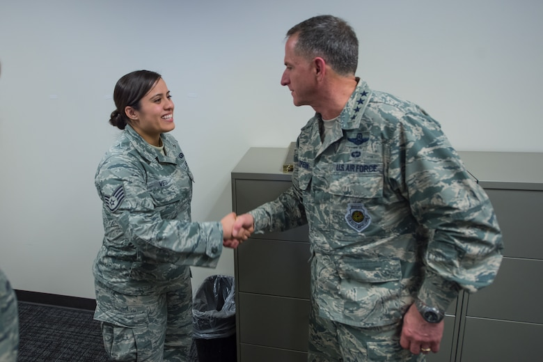 Air Force Vice Chief of Staff Gen. David L. Goldfein presents his coin to Staff Sgt. Monica Vega, Noncommissioned Officer in Charge of the Commanders Support Staff, 834th Cyber Operations Squadron during a visit at Joint Base San Antonio, Texas March 3. Goldfein also received briefings focused on 24th Air Force – AFCYBER's command and control of cyber forces and took the opportunity to personally thank the cyber warriors as well as to stress the significance of cyber in today's multi-domain operations. (U.S. Air Force photo by MSgt Luke P. Thelen/Released)